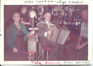 Grandfather with accordion in tavern 1960s