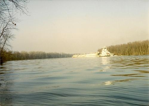 Towboat-barge moving upstream